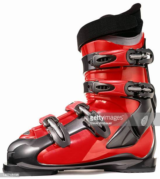 A profile of a single modern red ski boot