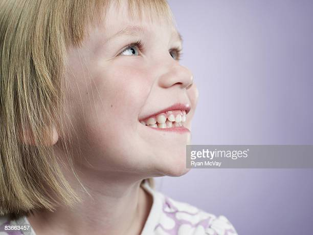 Profile of a smiling 5 year old girl.