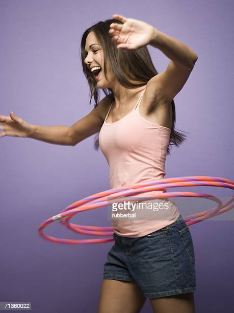 Profile of a woman with hula hoops
