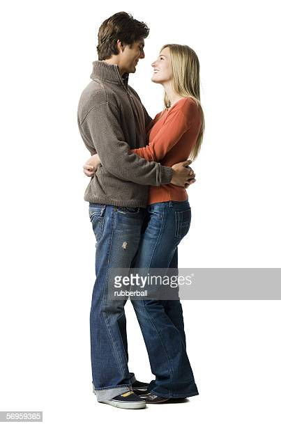 Profile of a young couple embracing each other