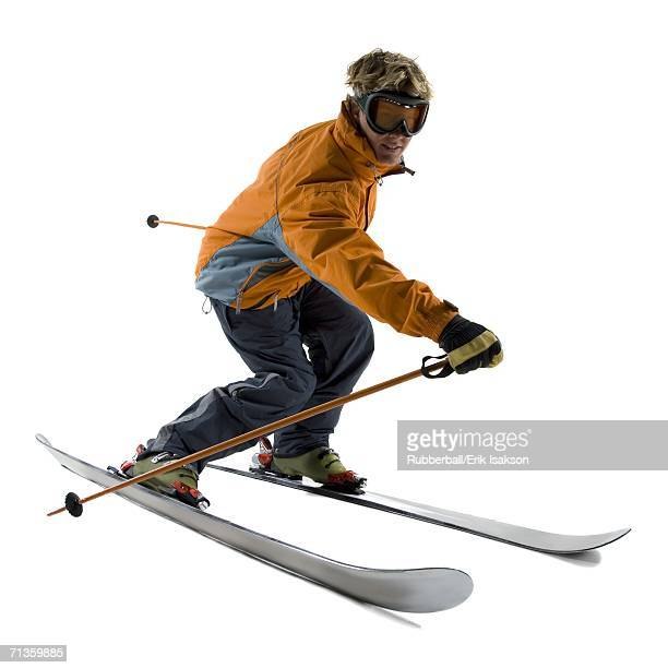 Profile of a young man skiing