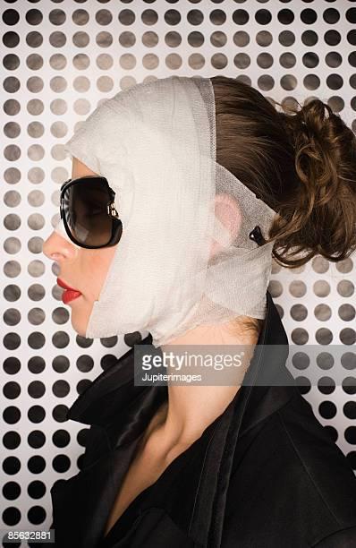 Profile of bandaged woman