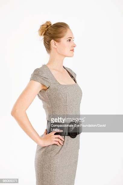 Profile of blonde woman wearing a dress