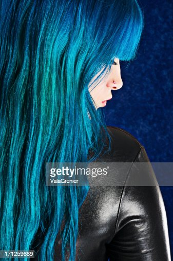 Profile of blue haired woman in black.