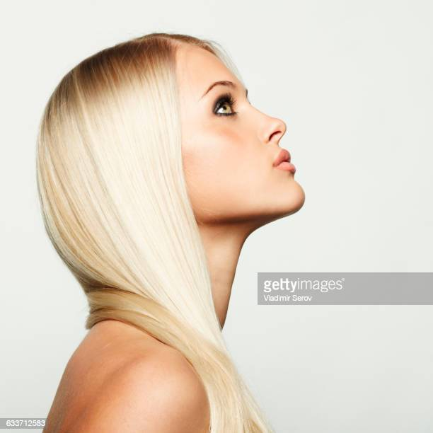 Profile of Caucasian woman looking up