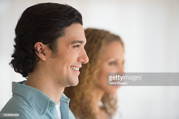 Profile of couple with focus on man in foreground
