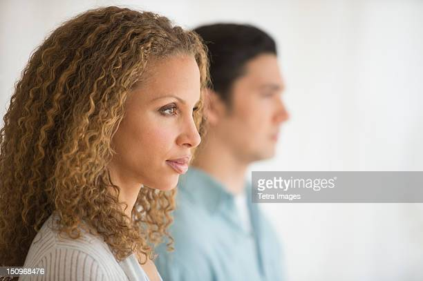 Profile of couple with focus on woman in foreground