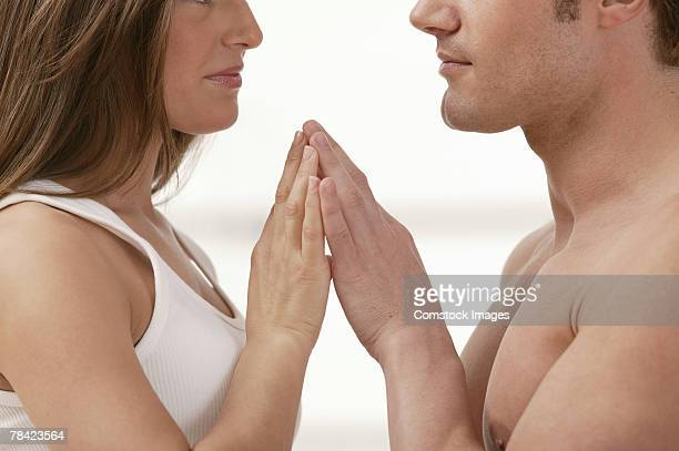 Profile of couple with hands touching