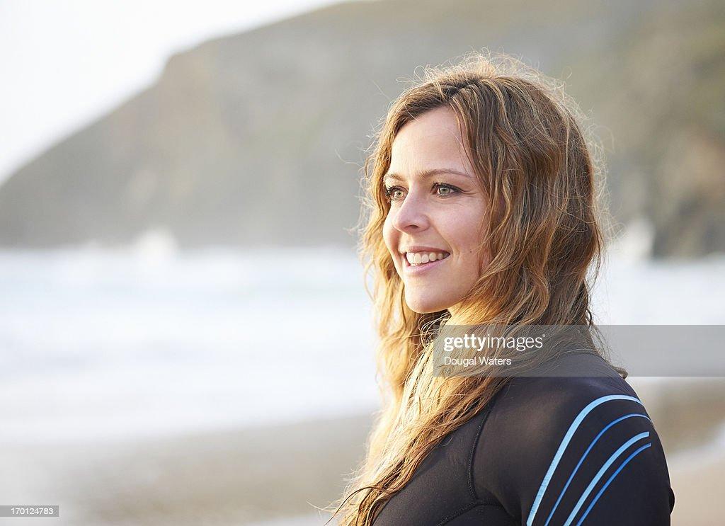 Profile of female surfer smiling. : Stock Photo