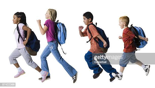 Profile of four children running in a row