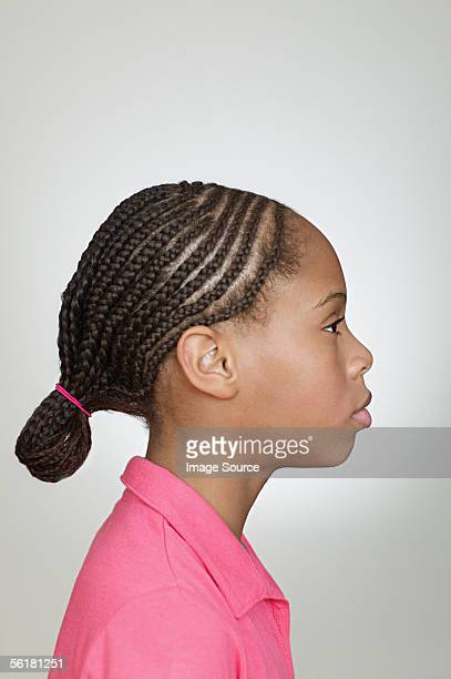 Profile of girl with braided hair