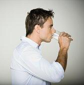 Profile of man drinking milk