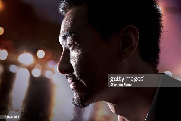 Profile of Man in front of City Lights
