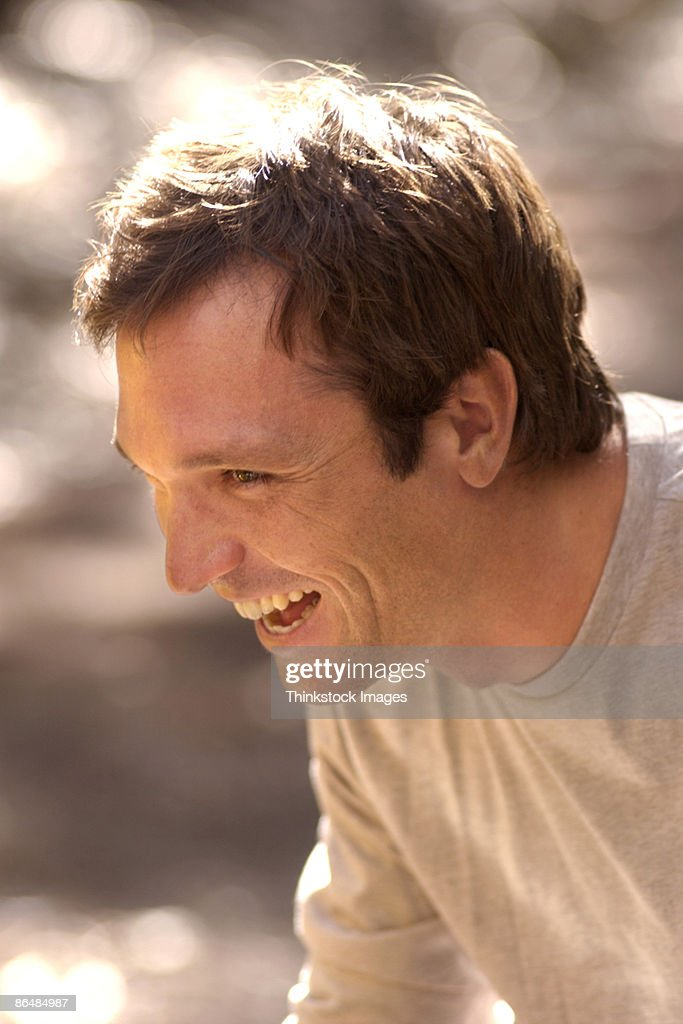 Profile of man laughing : Stock Photo