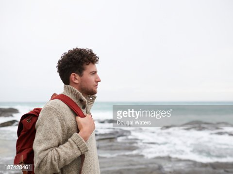 Profile of man on UK coastline.