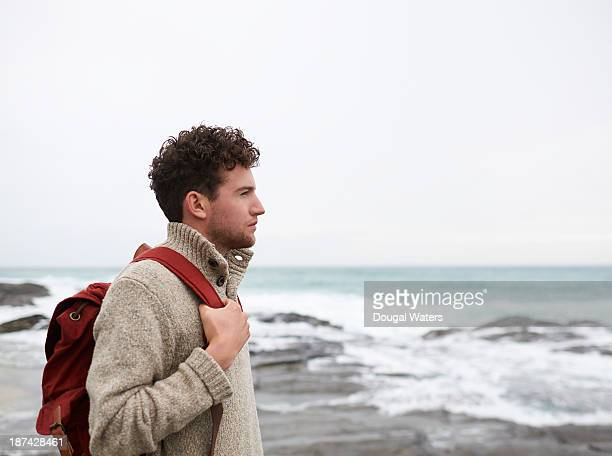 Profile of man on UK coastline.