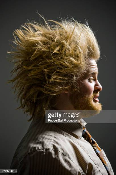 profile of man with crazy hair
