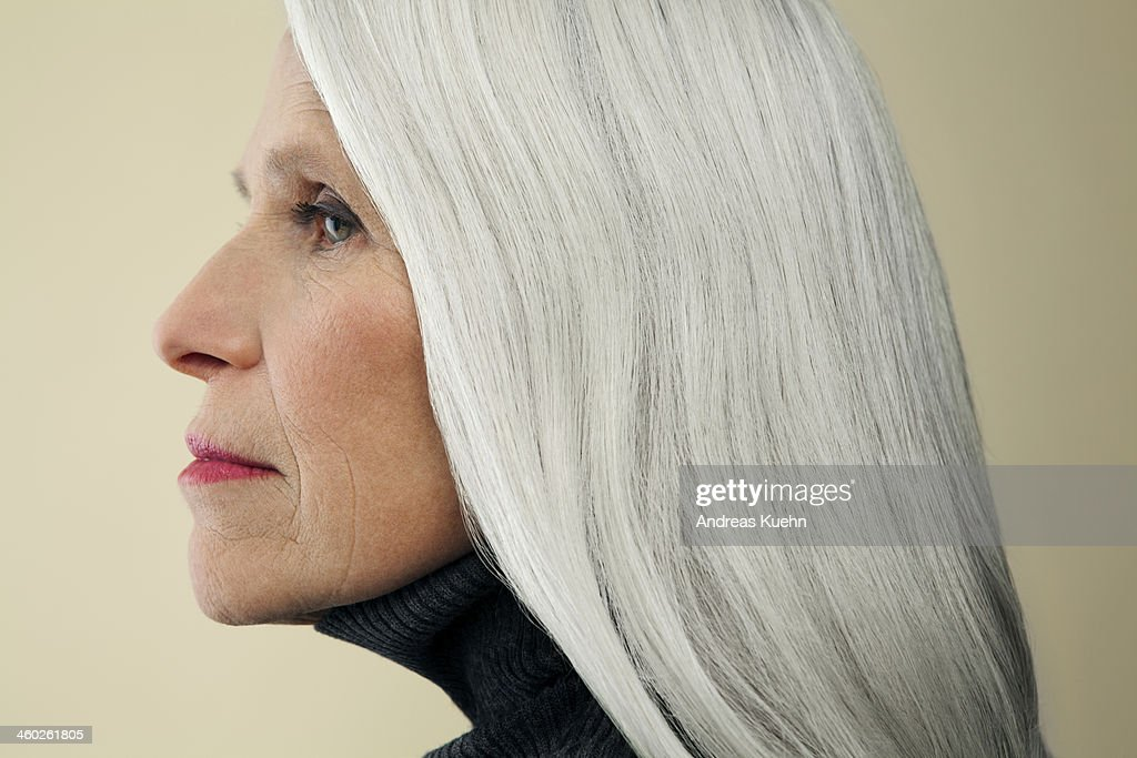Profile of mature woman with long, gray hair. : Stock Photo