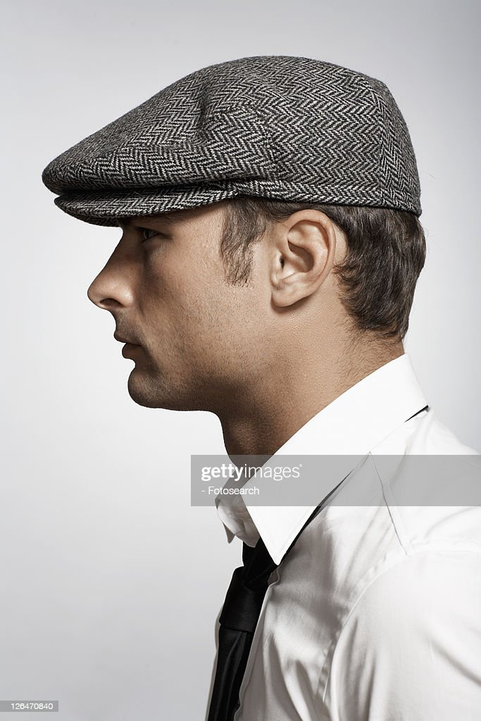 Profile of mid adult man wearing cap