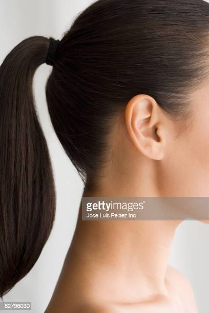 Profile of mixed race woman with ponytail