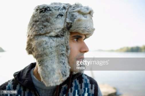 profile of sad looking young man at lakeside