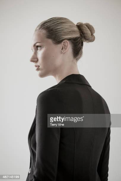Profile of serious Caucasian businesswoman looking away