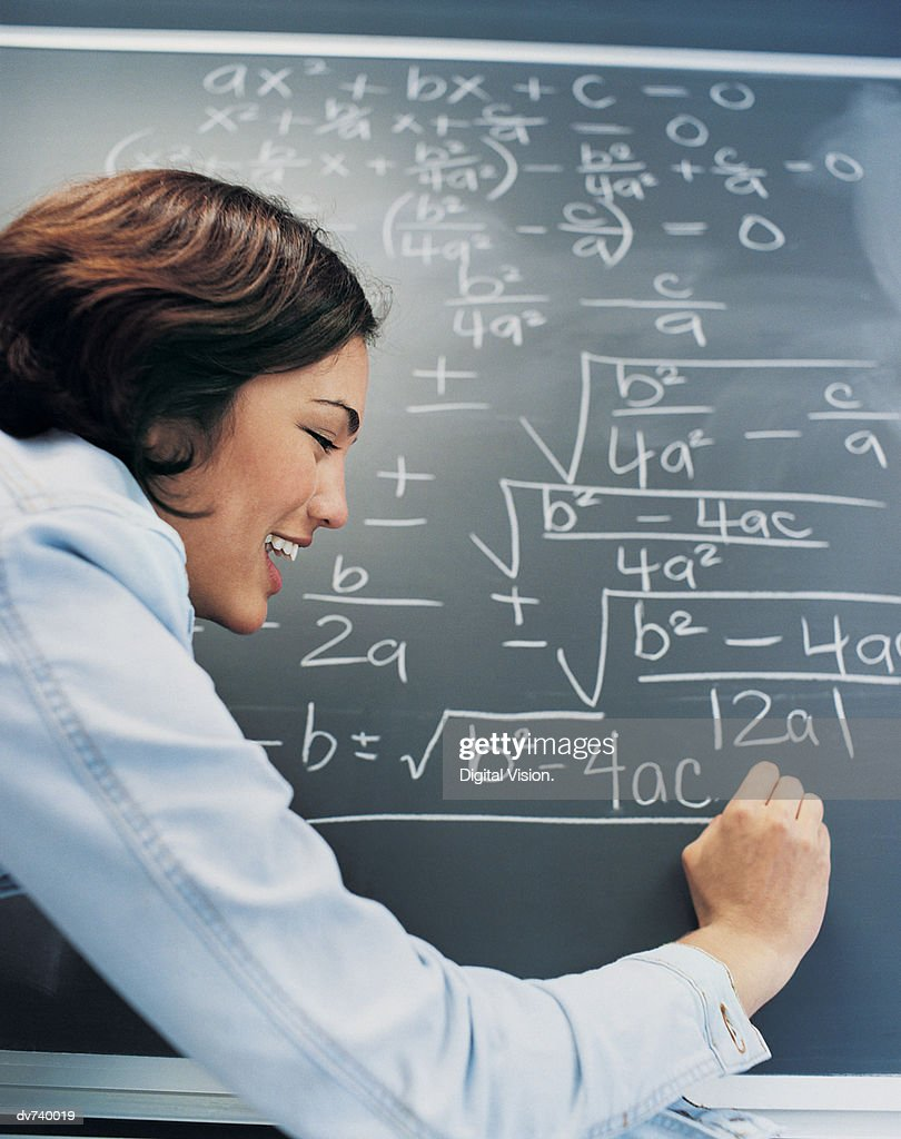 Profile of Student Writing Algebra on Blackboard : Stock Photo