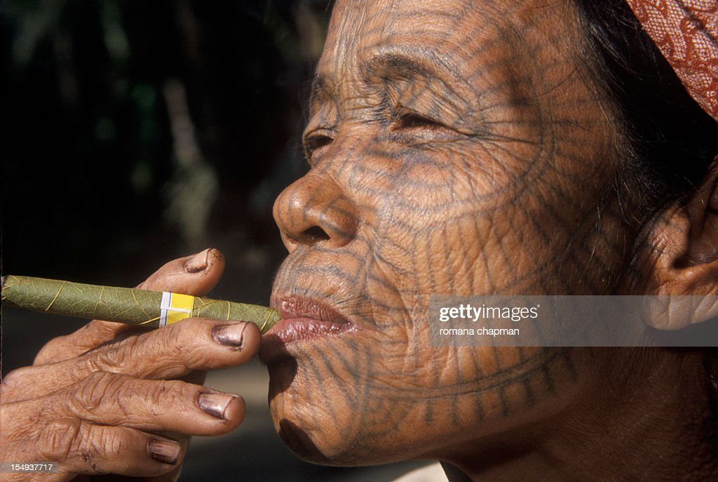 Profile of Tribal woman with tattooed face : Stock Photo
