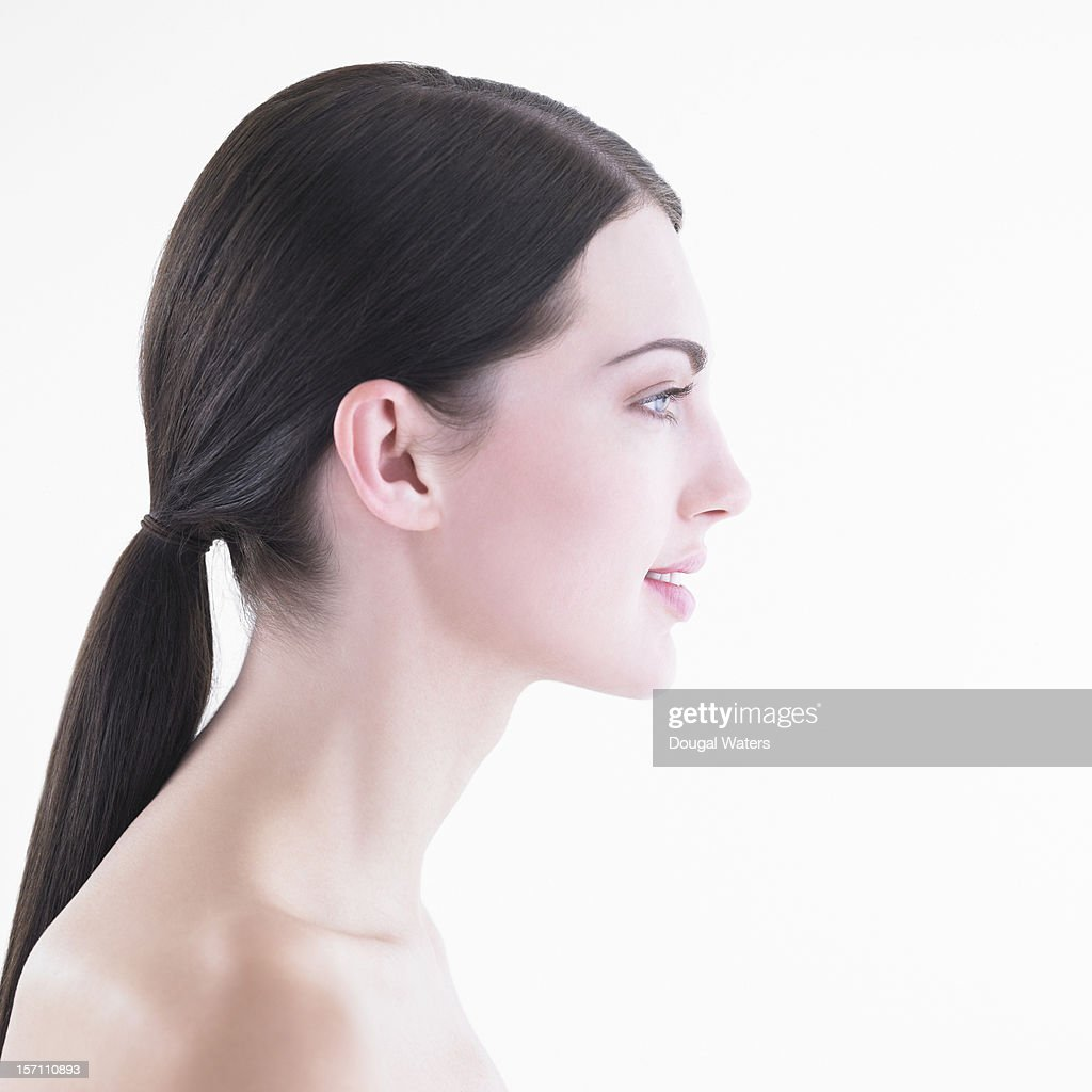 Profile of woman against white background. : Stock Photo