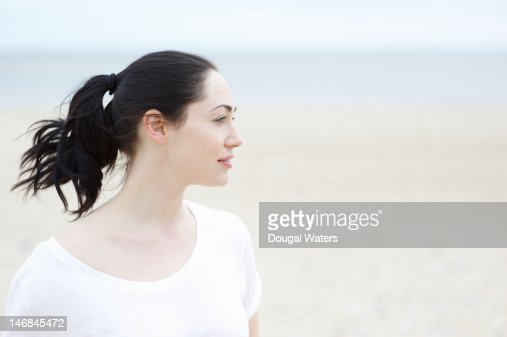 Profile of woman at beach. : Stock Photo