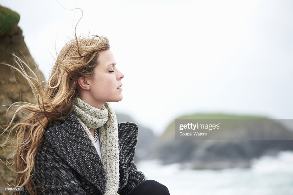 Profile of woman at beach with eyes closed. : Stock Photo