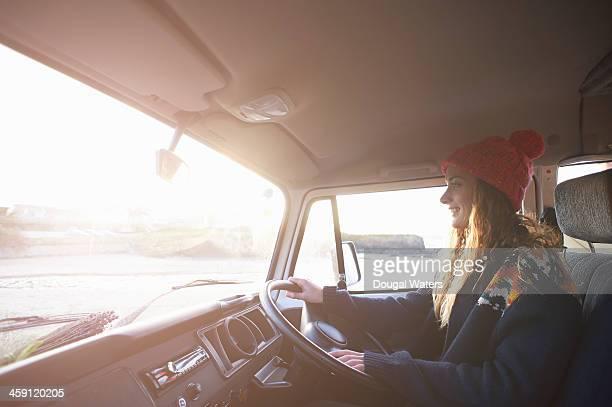 profile of woman driving camper van.