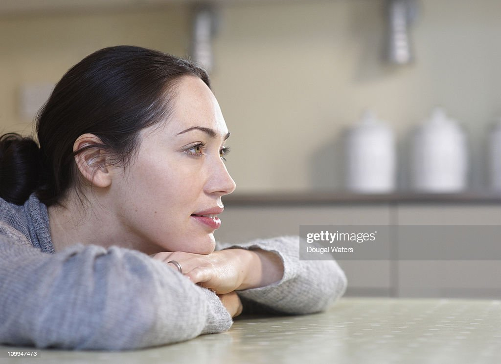 Profile of woman in kitchen : Stock Photo