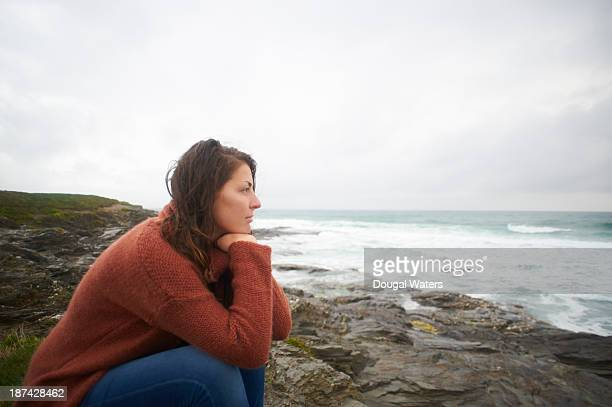 Profile of woman looking out to sea.