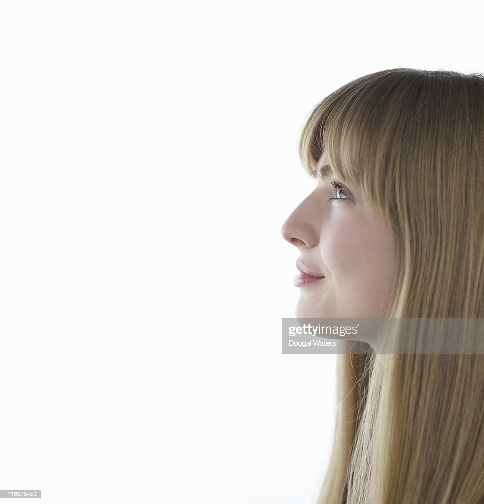 Profile of woman looking up smiling. : Stock Photo