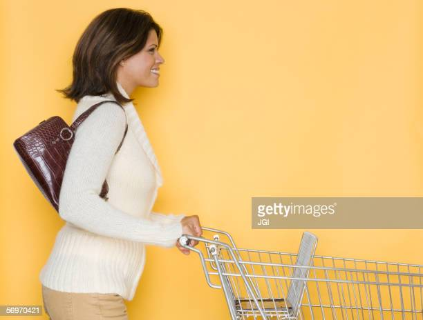 Profile of woman pushing shopping cart