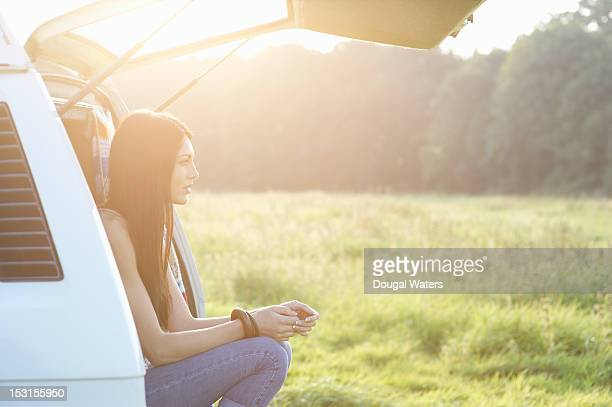 Profile of woman sitting in Summer meadow.