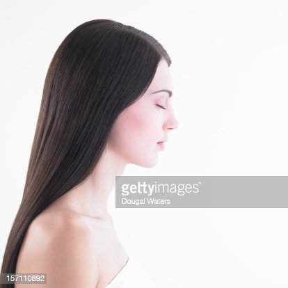 Profile of woman with eyes closed.