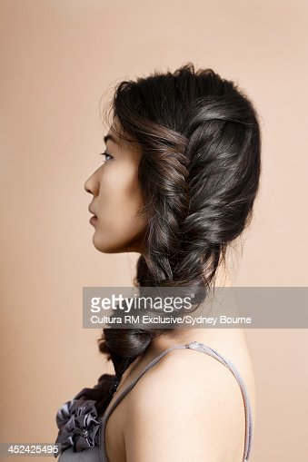 Profile of woman with hair plaited