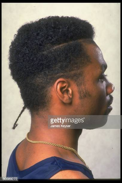 Profile of young black man w spiffy hairdo tiny ponytail