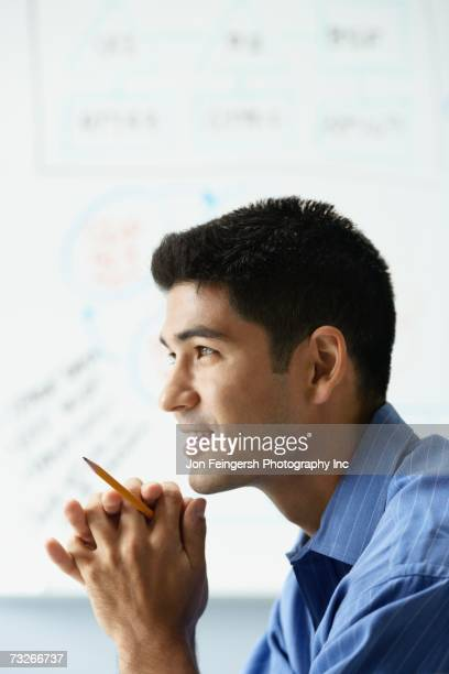 Profile of young businessman in front of whiteboard
