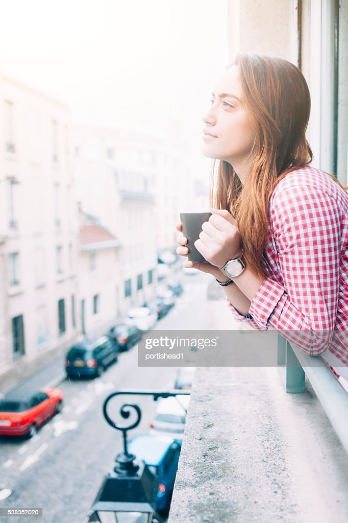Profile of young woman drinking coffee : Stock Photo