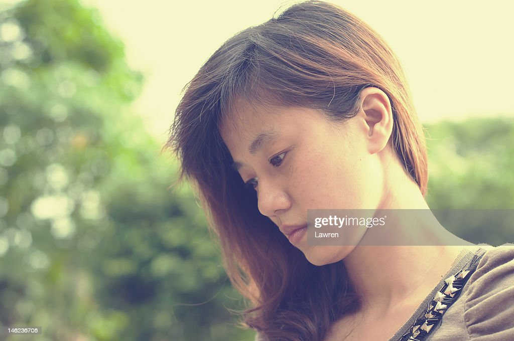 Profile of young woman : Stock Photo