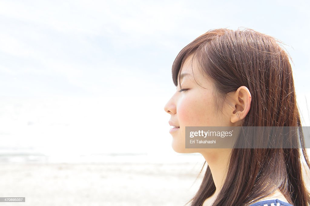Profile of young woman with eyes closed : Stock Photo