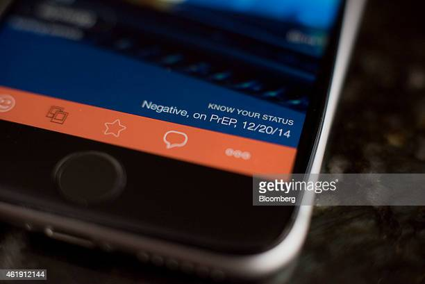 A profile page showing the HIV status of a user is seen on the gay dating app Hornet displayed for a photograph on an Apple Inc iPhone in Tiskilwa...