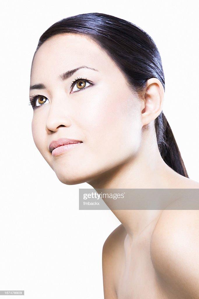 Profile photo of a naturally beautiful Asian woman : Stock Photo