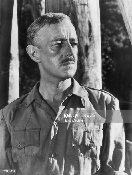 Profile portrait of British actor Alec Guinness in a still from director David Lean's film 'Bridge on the River Kwai'