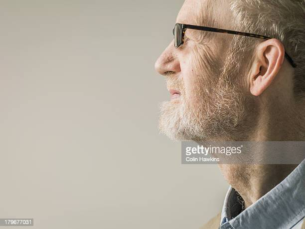profile portrait of elderly man with glasses