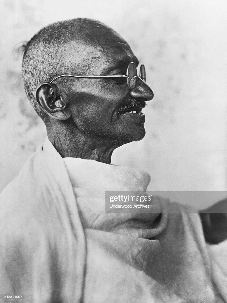 A profile portrait of Indian leader Mahatma Gandhi who led a successful nonviolent civil disobedience movement against British rule in India India...