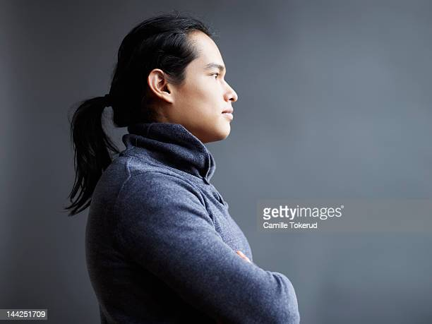 Profile view of a young man with long hair